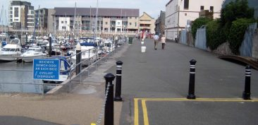 Caernarfon Marina Dismount sign unnecessary and intimidating.  Advisory. Not mandatory.