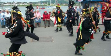 Conwy Quayside. Maurice Clarke (red) enjoying the entertainment